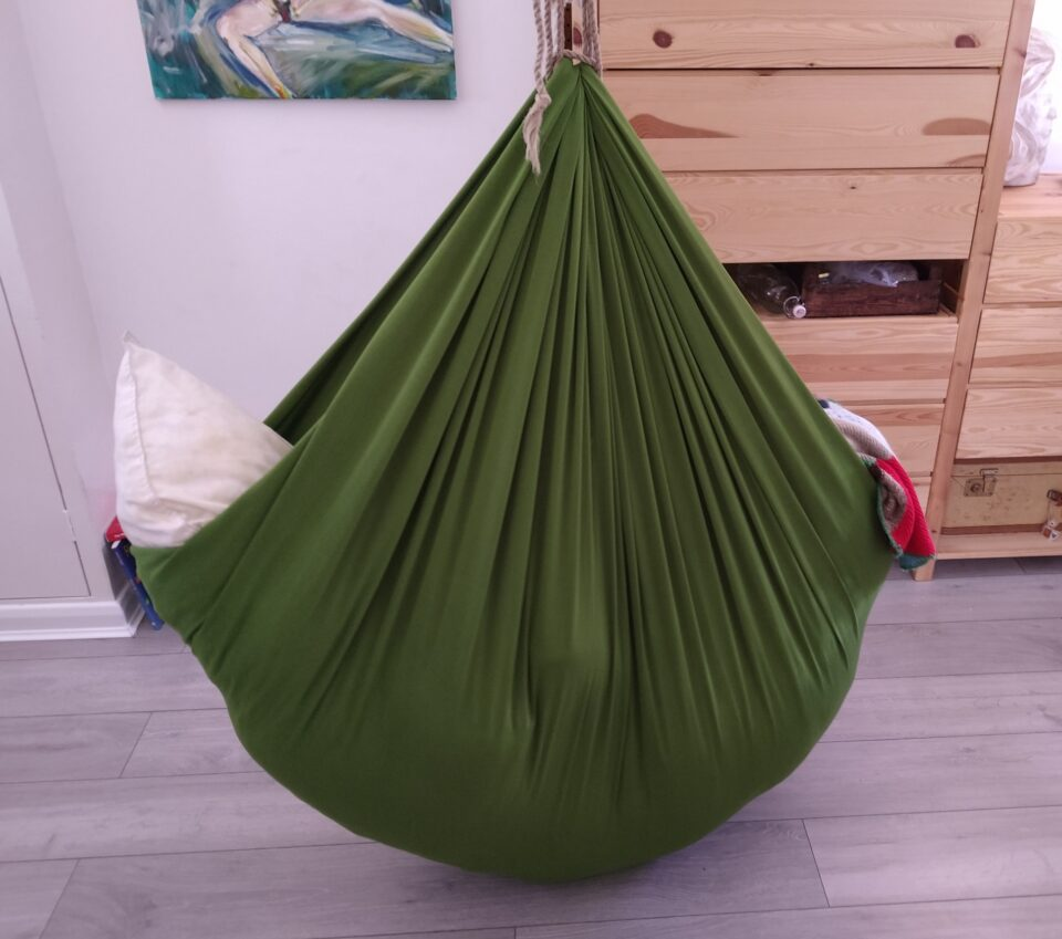 A den created in a green hammock