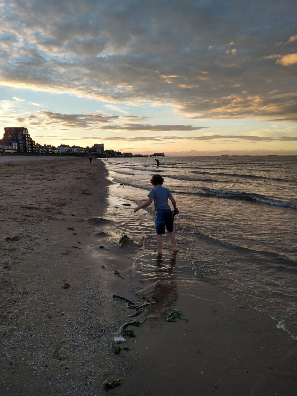 A sunset walk on a beach at Cleethorpes